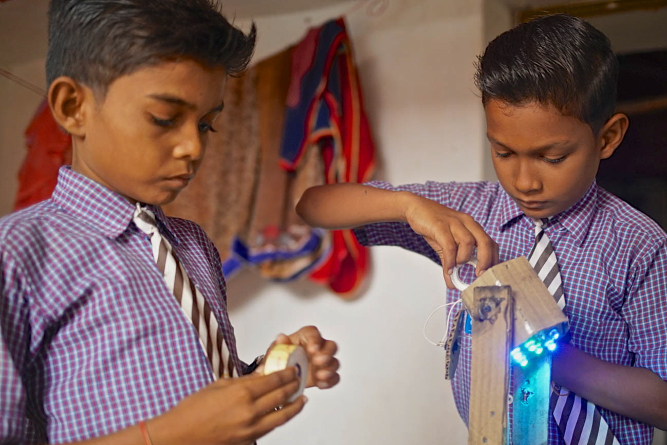 Birajveer and Puspit building a blue light
