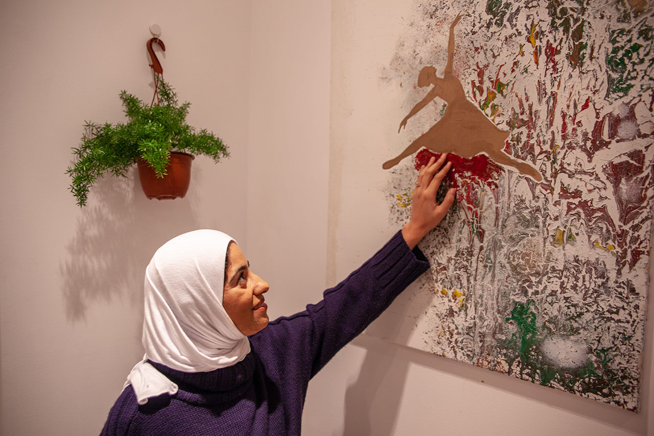 Manahil showing her painting