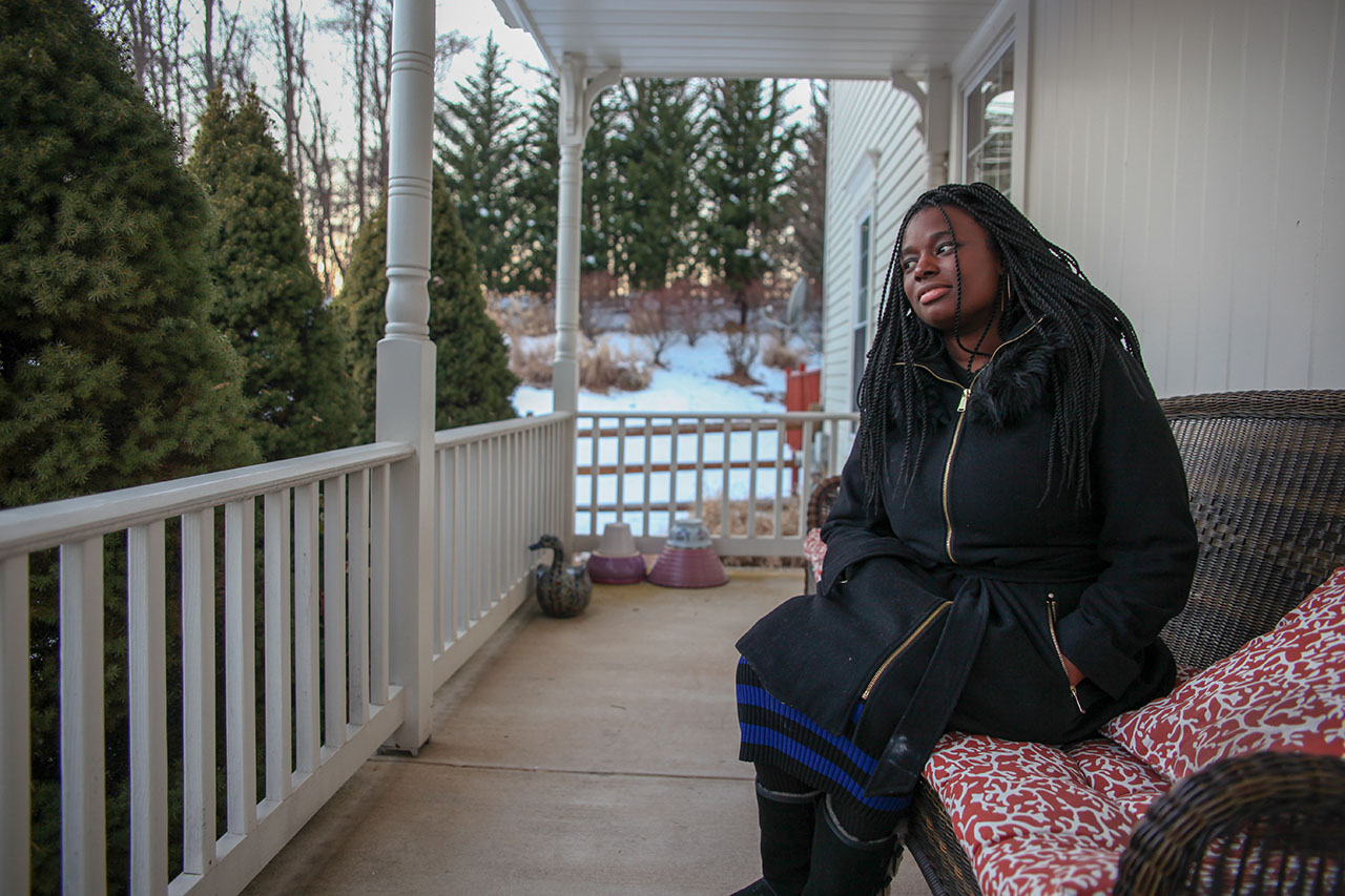 Teonna sitting on porch