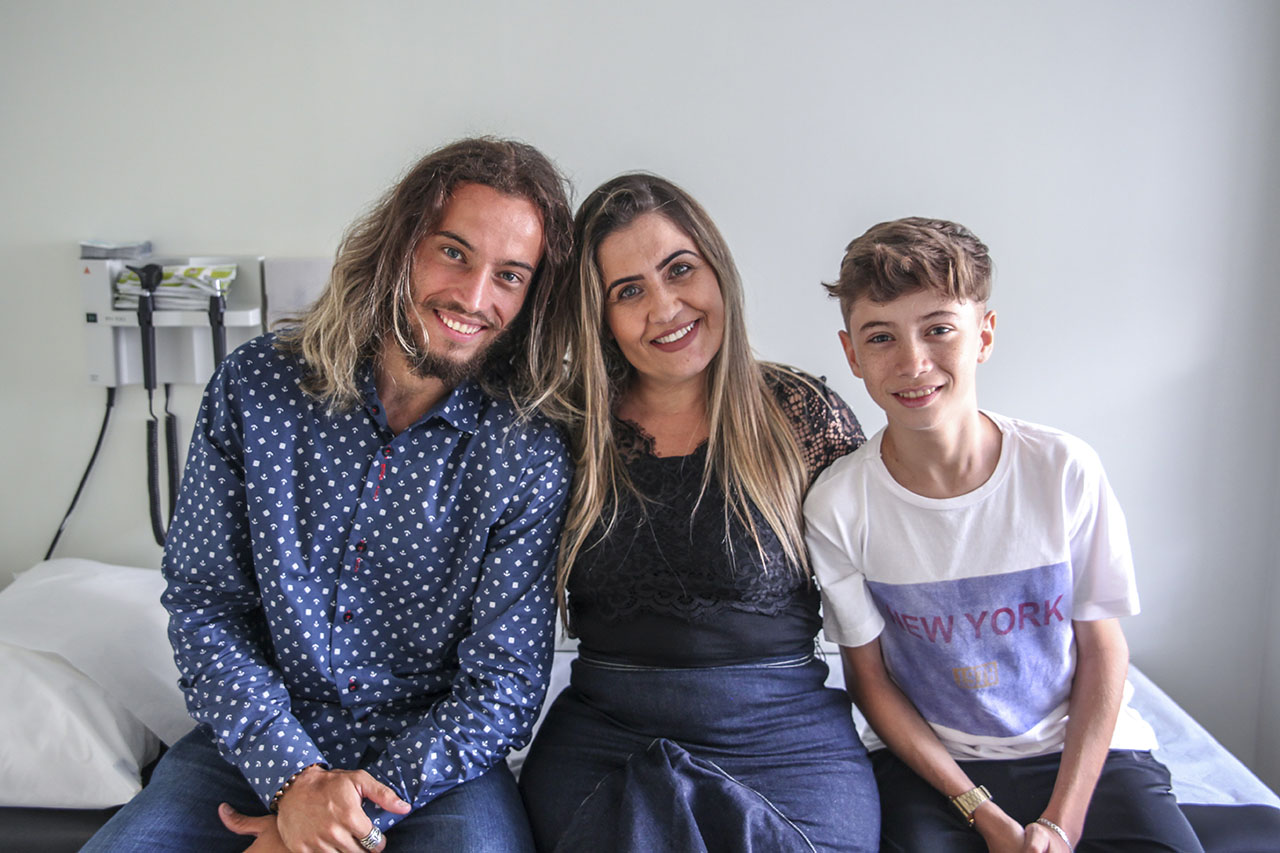 Yran smiling with family